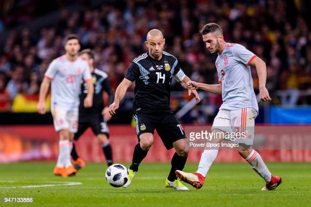 Jorge Koke of Spain in action against Javier Mascherano of Argentina during the International Friendly 2018 match between Spain and Argentina at...