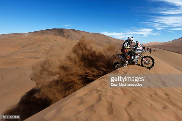Jorge Lacunza of Argentina for Lacunza rally Team 450 Rally Replica KTM asks for help from fans after getting stuck on the top of a sand dune during...