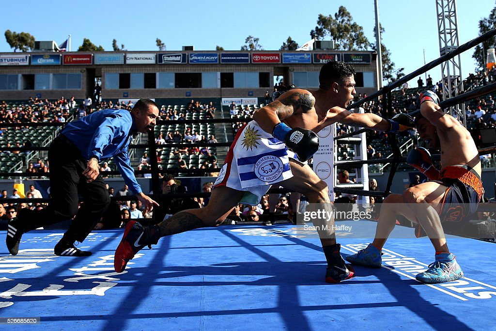 Jorge Lara punches Fernando Montiel knocking him down as referee Ray Corona steps in during a featherweight fight at StubHub Center on April 30, 2016 in Carson, California.