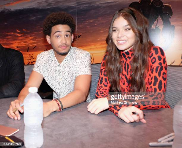 John Cena Travis Knight Jorge Lendeborg Jr and Hailee Steinfeld sign fan posters for 'Bumblebee' at ComicCon International 2018 on July 20 2018 in...
