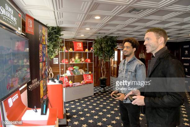 Jorge Lendeborg Jr and Travis Knight test their skills on Super Smash Bros Ultimate for Nintendo Switch at the Variety Studio at ComicCon 2018 on...