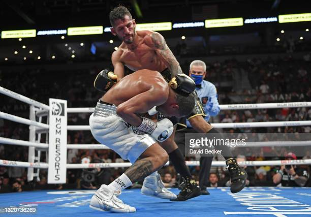 Jorge Linares holds Devin Haney down during their WBC lightweight title fight at Michelob ULTRA Arena on May 29, 2021 in Las Vegas, Nevada. Haney won...