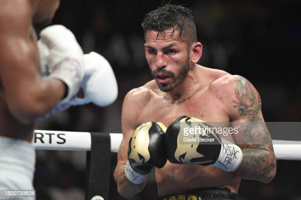 Jorge Linares looks on during his WBC lightweight title fight against Devin Haney at Michelob ULTRA Arena on May 29, 2021 in Las Vegas, Nevada. Haney...