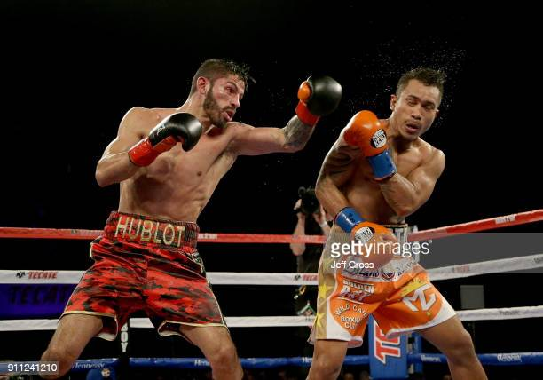 Jorge Linares of Venezuela connects with a left hand to the head of Mercito Gesta during their bout at The Forum on January 27 2018 in Inglewood...