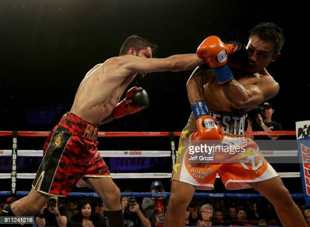 Jorge Linares of Venezuela connects with a right hand to the head of Mercito Gesta during their bout at The Forum on January 27 2018 in Inglewood...