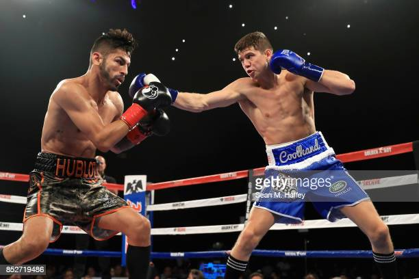 Jorge Linares of Venezuela exchanges punches with Luke Campbell of Great Britain during their WBA lightweight title bout at The Forum on September...