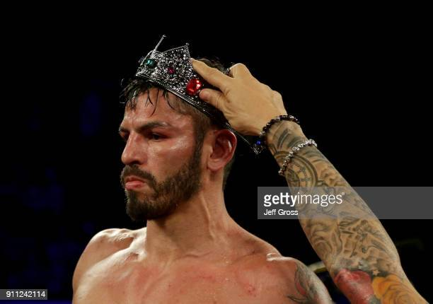Jorge Linares of Venezuela has a crown placed atop his head following his victory over Mercito Gesta at The Forum on January 27 2018 in Inglewood...