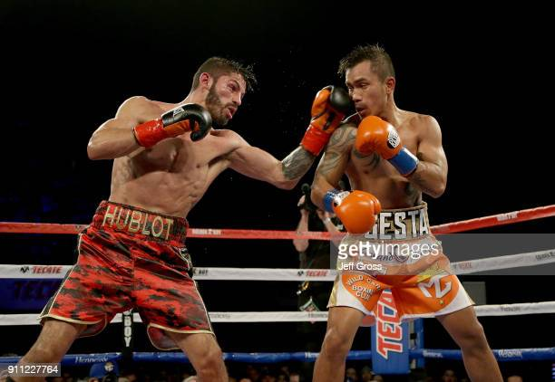 Jorge Linares of Venezuela lands a left hand to the head of Mercito Gesta during their bout at The Forum on January 27 2018 in Inglewood California