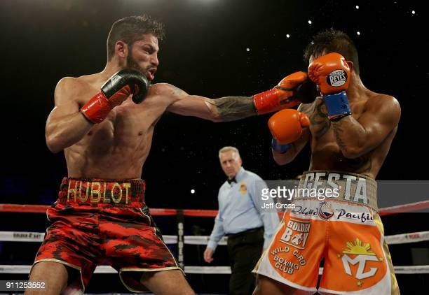 Jorge Linares of Venezuela throws a left hand at Mercito Gesta during their bout at The Forum on January 27 2018 in Inglewood California