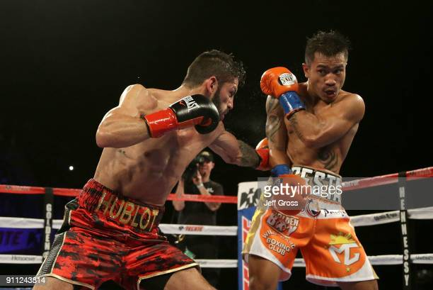 Jorge Linares of Venezuela throws a left hand to the body of Mercito Gesta during their bout at The Forum on January 27 2018 in Inglewood California