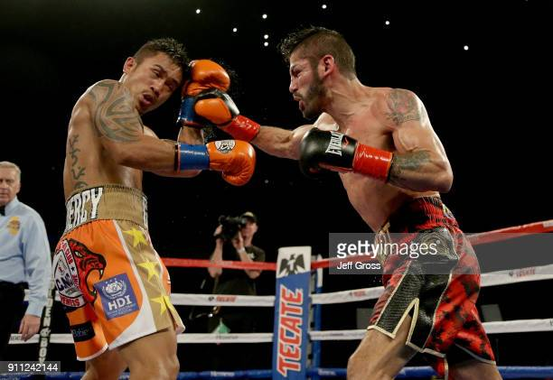 Jorge Linares of Venezuela throws a right hand at Mercito Gesta during their bout at The Forum on January 27 2018 in Inglewood California