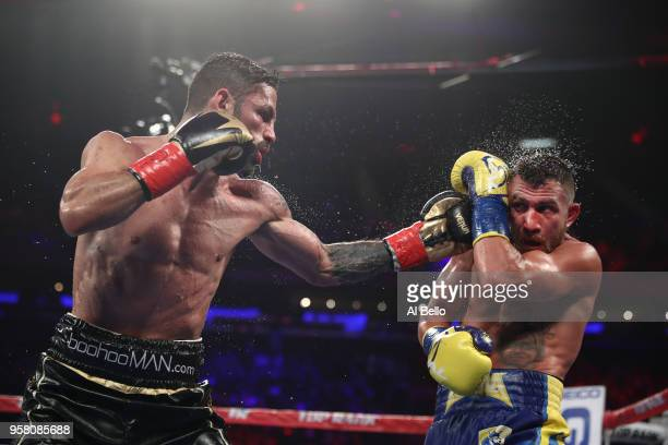 Jorge Linares punches Vasiliy Lomachenko during their WBA lightweight title fight at Madison Square Garden on May 12 2018 in New York City