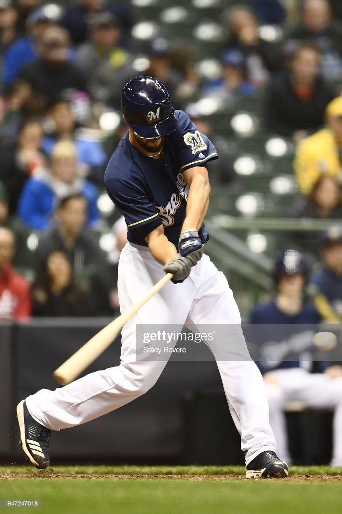 Jorge Lopez #28 of the Milwaukee Brewers hits a two run double against the Cincinnati Reds during the seventh inning at Miller Park on April 16, 2018 in Milwaukee, Wisconsin.