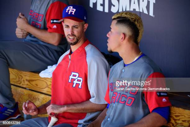 Jorge Lopez talks with Jose Berrios of Puerto Rico during an exhibition game against the Colorado Rockies on March 9 2017 in Scottsdale Arizona