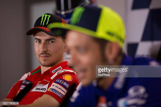 Jorge Lorenzo of Ducati Team looks Valentino Rossi of Movistar Yamaha MotoGP during the presentation press conference of the OCTO Grand Prix of San...