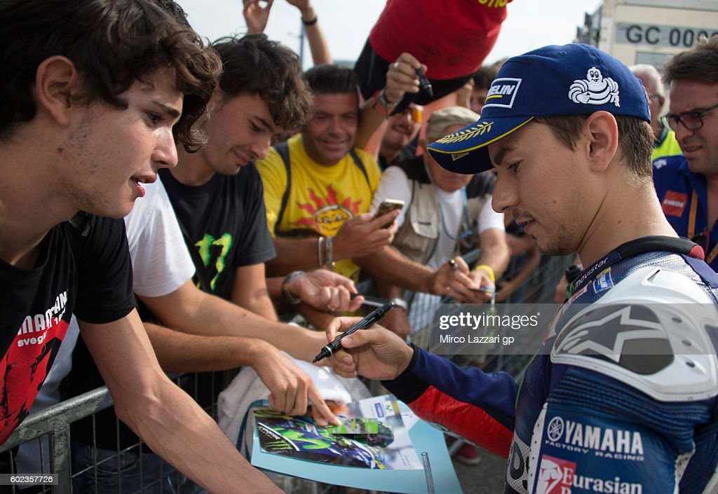 Jorge Lorenzo of Movistar Yamaha MotoGP signs autograhps after the MotoGP of San Marino race at Misano World Circuit on September 11, 2016 in Misano Adriatico, Italy.
