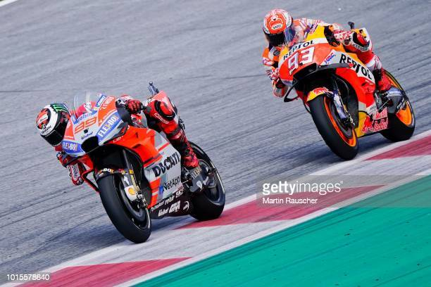 Jorge Lorenzo of Spain and Ducati Team and Marc Marquez of Spain and Repsol Honda Team during the MotoGp of Austria Race at Red Bull Ring on August...