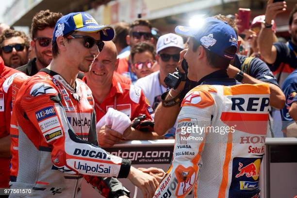 Jorge Lorenzo of Spain and Ducati Team and Marc Marquez of Spain and Repsol Honda Team during the qualifying of the Gran Premi Monster Energy de...