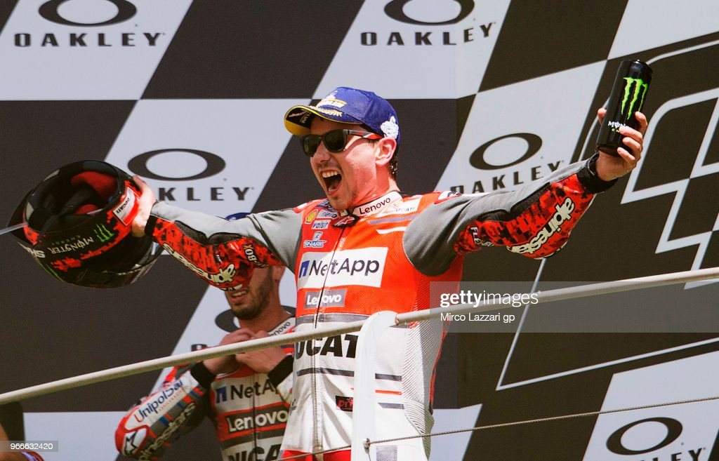 Jorge Lorenzo of Spain and Ducati Team celebrates the victory on the podium at the end of the MotoGP race during the MotoGp of Italy - Race at Mugello Circuit on June 3, 2018 in Scarperia, Italy.