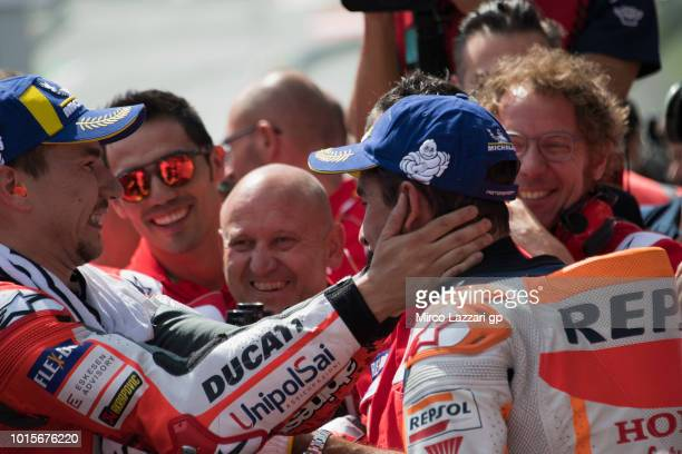 Jorge Lorenzo of Spain and Ducati Team congratulates with Marc Marquez of Spain and Repsol Honda Team at the end of the MotoGP race during the MotoGp...