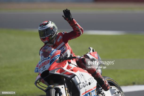 Jorge Lorenzo of Spain and Ducati Team greets the fans at the end of the MotoGP race during the MotoGp Of Great Britain Race at Silverstone Circuit...