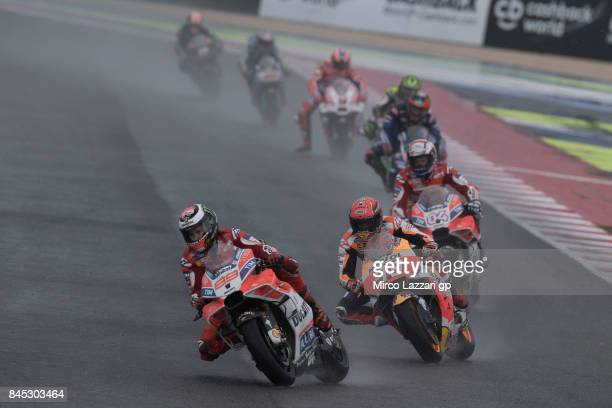 Jorge Lorenzo of Spain and Ducati Team leads the field during the MotoGP Race during the MotoGP of San Marino Race at Misano World Circuit on...