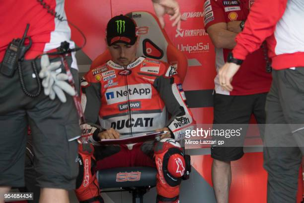 Jorge Lorenzo of Spain and Ducati Team looks on in box during the MotoGp of Spain Free Practice at Circuito de Jerez on May 4 2018 in Jerez de la...