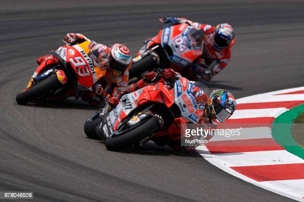 Jorge Lorenzo of Spain and Ducati Team Marc Marquez of Spain and Repsol Honda Team Andrea Dovizioso of Italy and Ducati Team during the race day of...