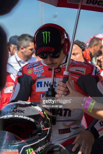 Jorge Lorenzo of Spain and Ducati Team prepares to start on the grid during the MotoGP race during the MotoGP of San Marino Race at Misano World...