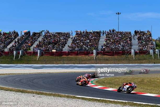 Jorge Lorenzo of Spain and Ducati Team rides ahead Marc Marquez of Spain and Repsol Honda Team Dani Pedrosa of Spain and Repsol Honda Team and Andrea...