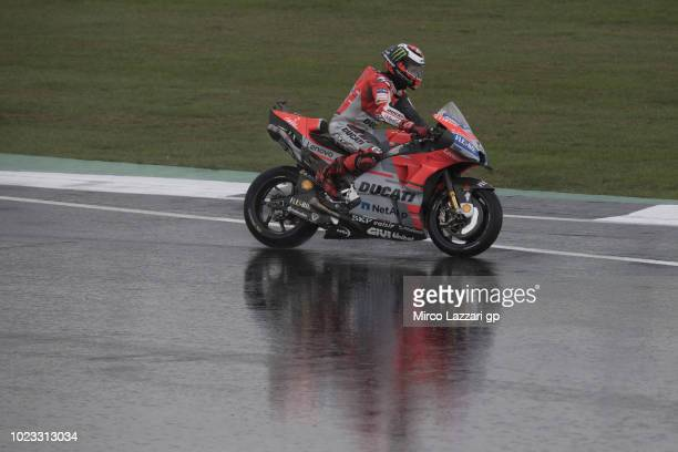 Jorge Lorenzo of Spain and Ducati Team rounds the bend during the qualfying practice during the MotoGp Of Great Britain Qualifying at Silverstone...