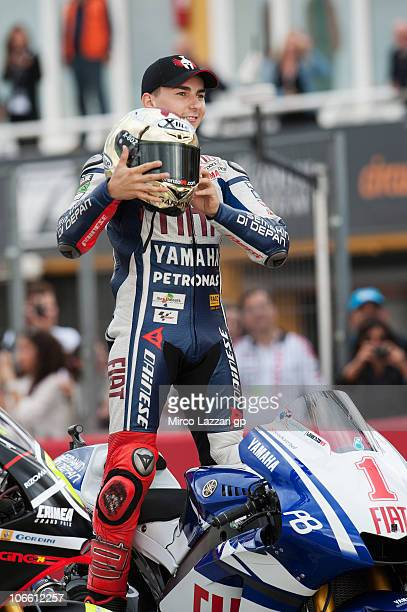 Jorge Lorenzo of Spain and Fiat Yamaha poses with his bike for the photo of the three Champions of the 2010 season at the end of the MotoGP of...
