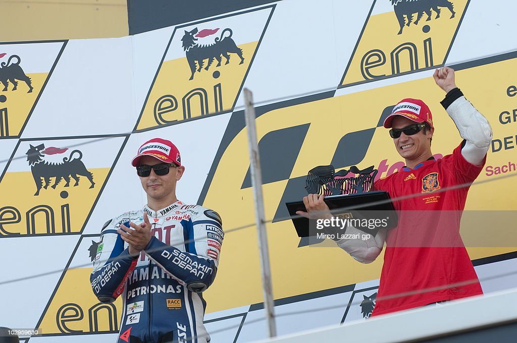 Jorge Lorenzo of Spain and Fiat Yamaha Team and Dani Pedrosa of Spain and Repsol Honda Team celebrate on the podium at the end of the MotoGP race of Grand Prix of Germany at Sachsenring Circuit on July 18, 2010 in Hohenstein-Ernstthal, Germany.
