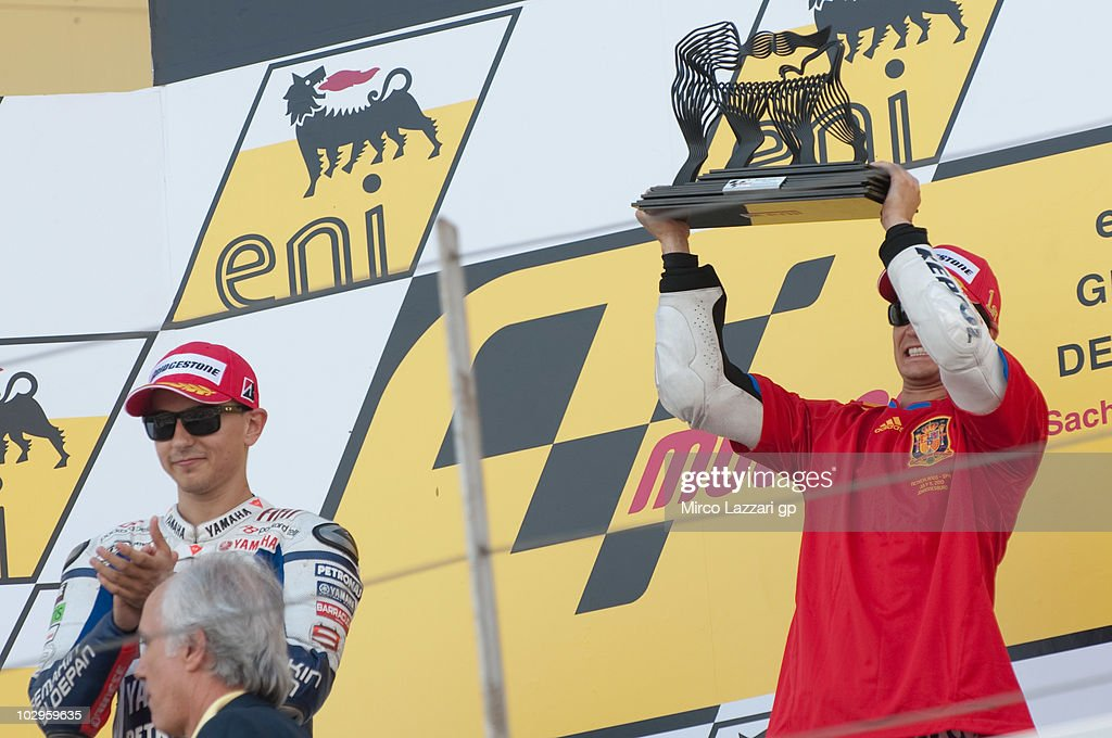 L-R Jorge Lorenzo of Spain and Fiat Yamaha Team and Dani Pedrosa of Spain and Repsol Honda Team celebrate on the podium at the end of the MotoGP race of Grand Prix of Germany at Sachsenring Circuit on July 18, 2010 in Hohenstein-Ernstthal, Germany.
