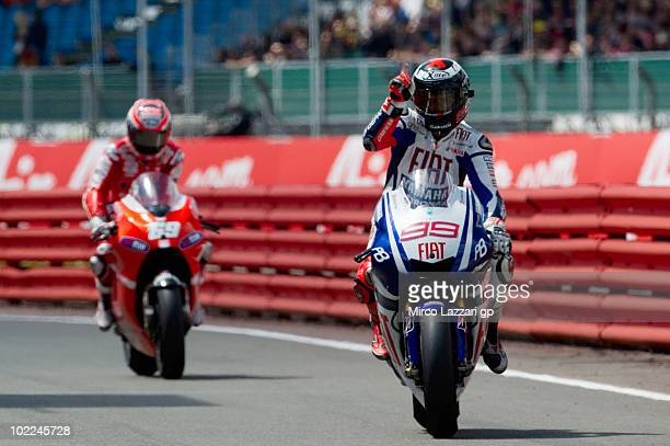 Jorge Lorenzo of Spain and Fiat Yamaha Team arrives under the podium and celebrates the victory at the end of MotoGP race of British Grand Prix at...