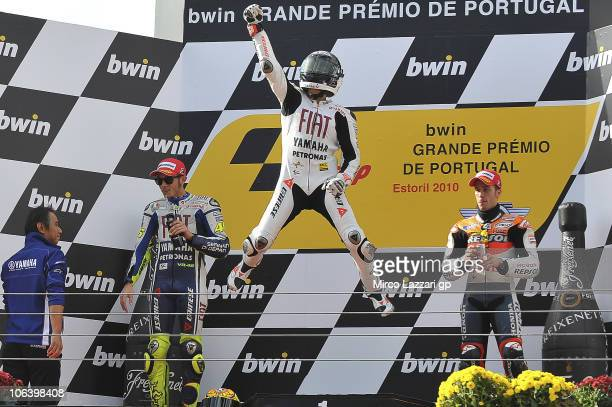 Jorge Lorenzo of Spain and Fiat Yamaha Team celebrates on the podium the victory at the end of MotoGP race of MotoGP of Portugal on October 31 2010...