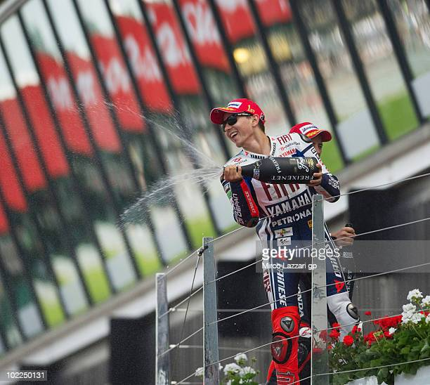 Jorge Lorenzo of Spain and Fiat Yamaha Team celebrates the victory on the podium and sprays champagne at the end of MotoGP race of British Grand Prix...