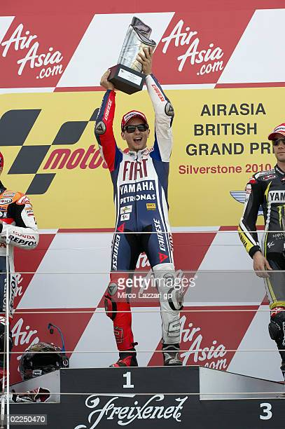 Jorge Lorenzo of Spain and Fiat Yamaha Team celebrates the victory on the podium at the end of MotoGP race of British Grand Prix at Silverstone...