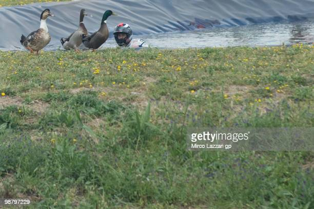 Jorge Lorenzo of Spain and Fiat Yamaha Team celebrates the victory and swimming on the lake with ducks at the end of the MotoGP race at Circuito de...