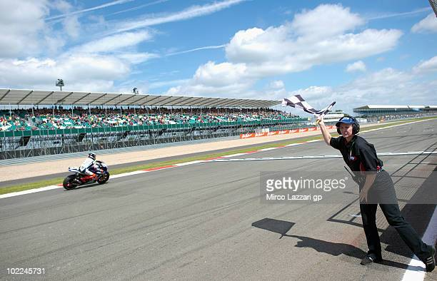 Jorge Lorenzo of Spain and Fiat Yamaha Team crosses the finish line and takes the victory at the end of MotoGP race of British Grand Prix at...