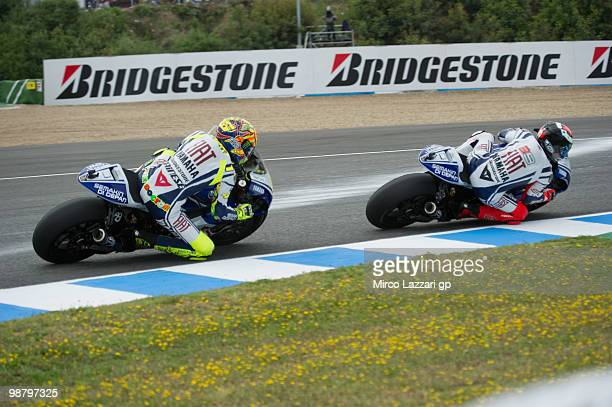 Jorge Lorenzo of Spain and Fiat Yamaha Team leads Valentino Rossi of Italy and Fiat Yamaha Team during the duel during the MotoGP race at Circuito de...