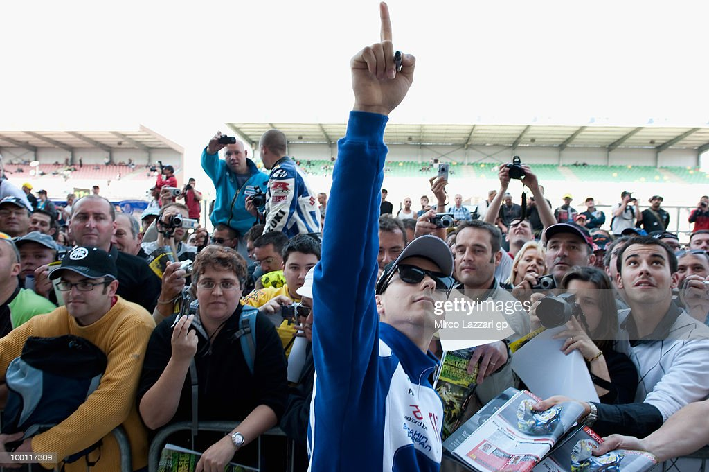 Jorge Lorenzo of Spain and Fiat Yamaha Team signs autographs for fans and greets the fans during the 'Pit Lane Walk' of the MotoGP French Grand Prix in Le Mans Circuit on May 21, 2010 in Le Mans, France.