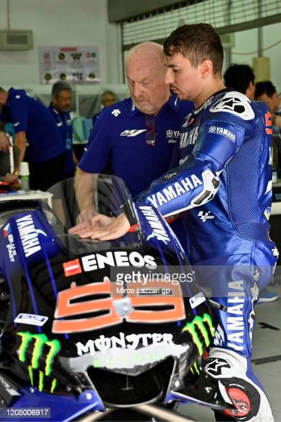 Jorge Lorenzo of Spain and Monster Energy Yamaha MotoGP Team speaks in box with Silvano Galbusera of Italy during the MotoGP Pre-Season Tests at...
