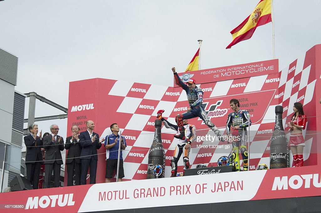 Jorge Lorenzo of Spain and Movistar Yamaha MotoGP celebrates the victory by jumping on the podium at the end of the MotoGP race during the MotoGP Of Japan - Race at Twin Ring Motegi on October 12, 2014 in Motegi, Japan.