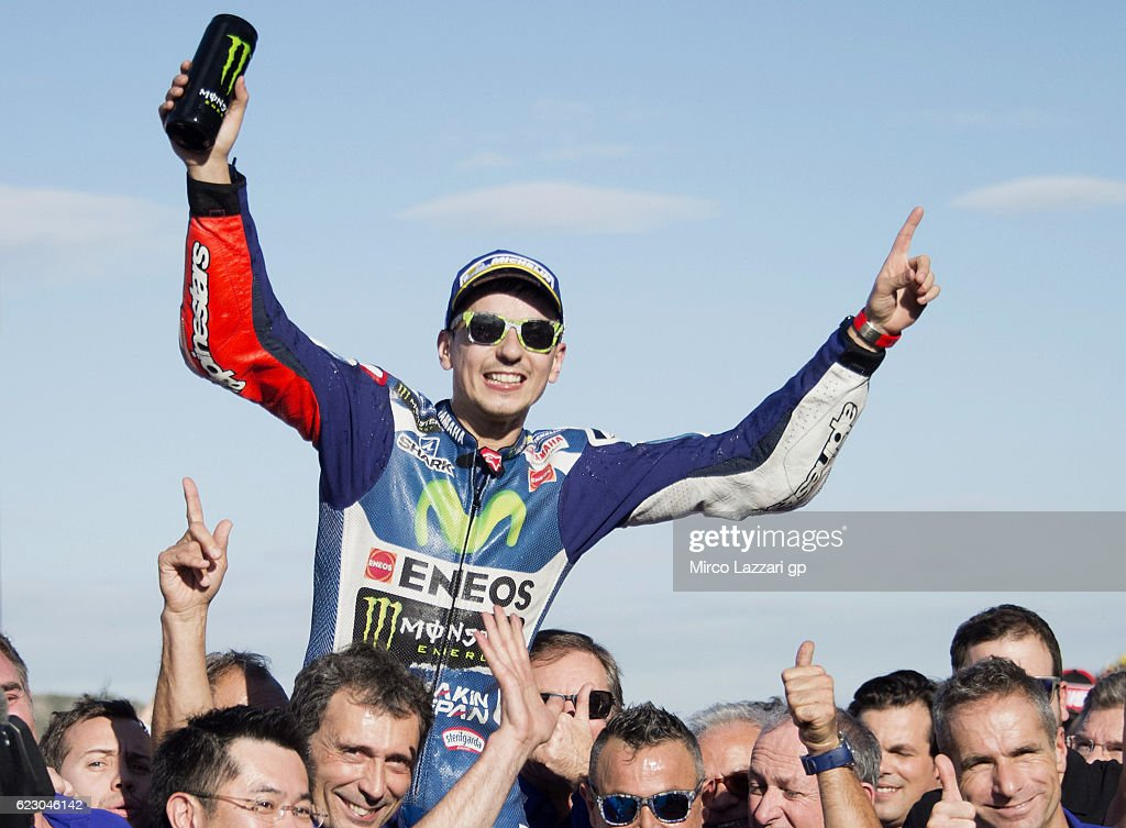 Jorge Lorenzo of Spain and Movistar Yamaha MotoGP celebrates the victory under the podium at the end of the MotoGP race during the MotoGP of Valencia - Race at Ricardo Tormo Circuit on November 13, 2016 in Valencia, Spain.