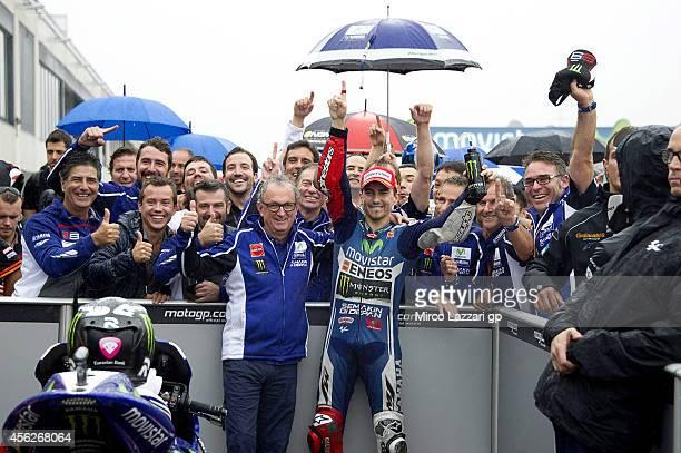 Jorge Lorenzo of Spain and Movistar Yamaha MotoGP celebrates under the podium with his team after winning the MotoGP of Spain at Motorland Aragon...