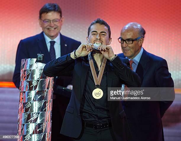 Jorge Lorenzo of Spain and Movistar Yamaha MotoGP celebrates with the medal of MotoGP World Champion during the 2015 FIM MotoGP Awards Ceremony at...