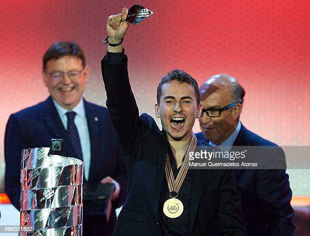 Jorge Lorenzo of Spain and Movistar Yamaha MotoGP celebrates with the medal of MotoGP World Champion during the 2015 FIM MotoGP Awards Ceremony at...