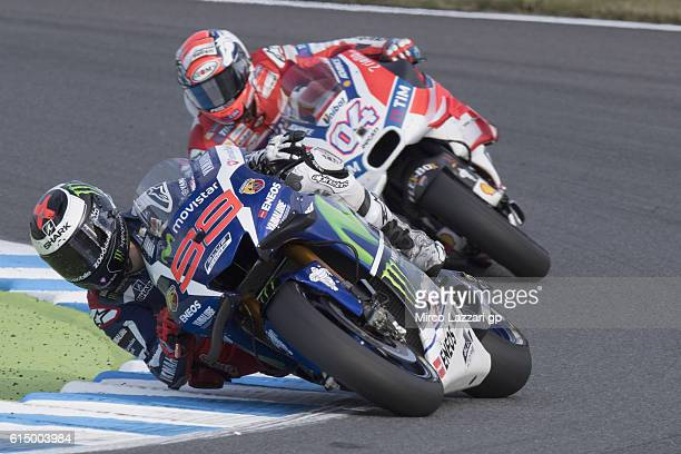 Jorge Lorenzo of Spain and Movistar Yamaha MotoGP leads Andrea Dovizioso of Italy and Ducati Team during the MotoGP race during the MotoGP of Japan...