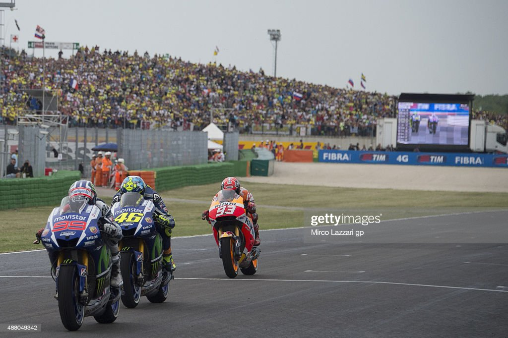Jorge Lorenzo of Spain and Movistar Yamaha MotoGP leads the field in the MotoGP World Championship race during the San Marino GP at Misano World Circuit on September 13, 2015 in Misano Adriatico, Italy.
